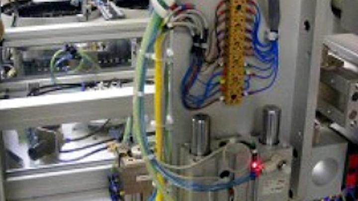 Vision assisted robot automates spigot production