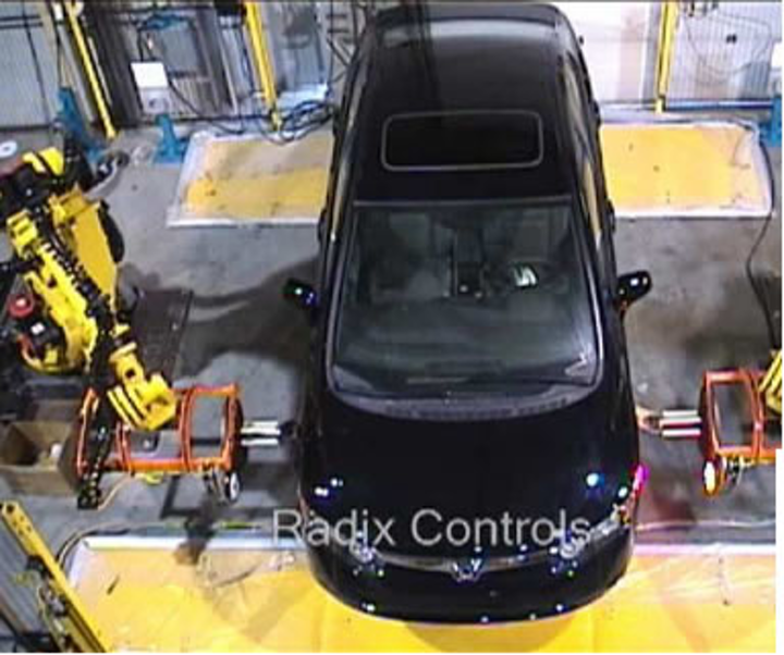 Vision-guided robot fastens lug nuts | Vision Systems Design