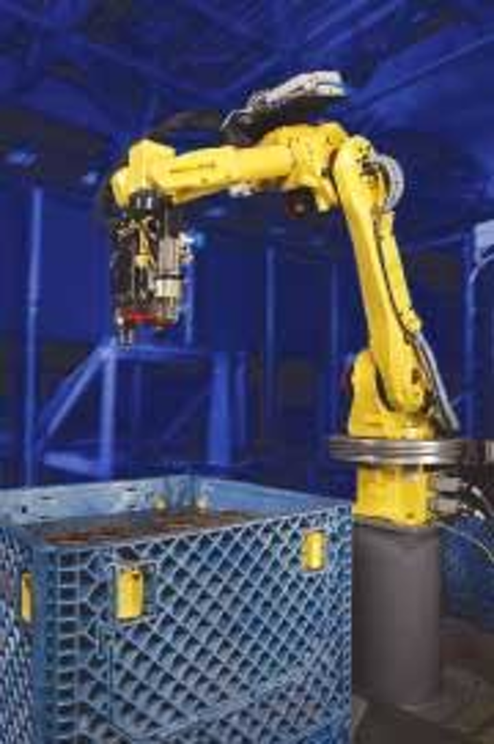 Robot system reduces operating costs | Vision Systems Design