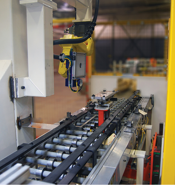 Robot-carried vision system inspects engine block surfaces