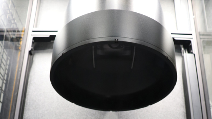 A large format, bi-telecentric lens provides a 240 mm field of view at a 375 mm working distance above the tray, where parts are gauged for required measurements.